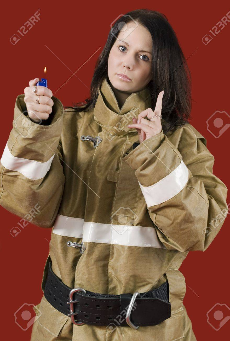 Girl in fireman uniform warns: Be careful with fire! Stock Photo - 7495242