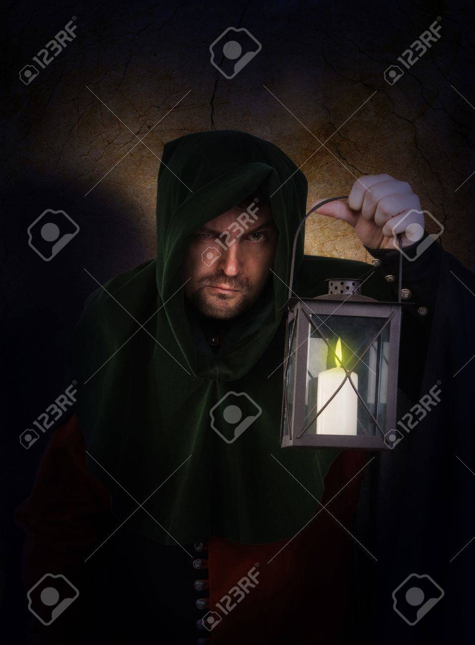 Night watchman in a medieval suit and hood with a lantern Stock Photo - 9058250
