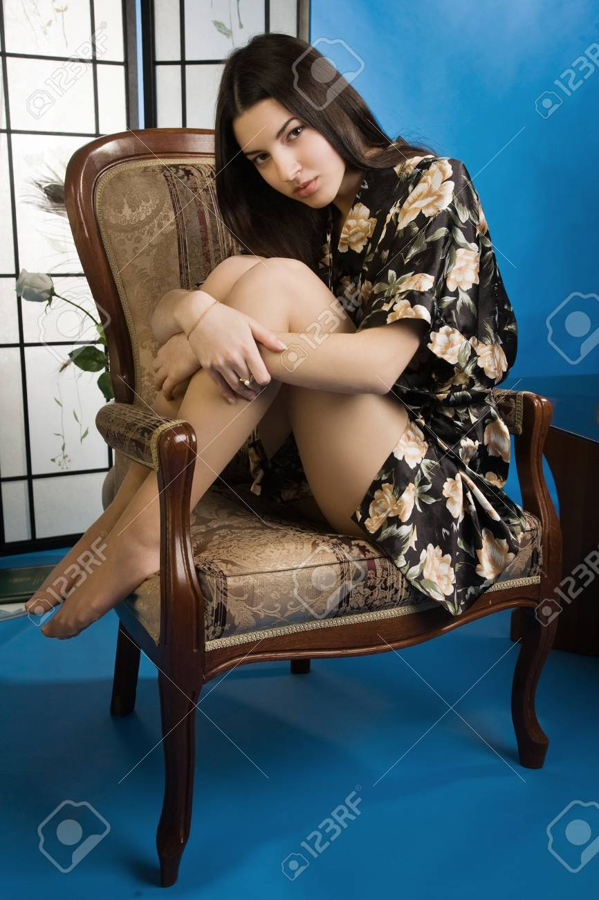 Attractive pretty lady sitting in the armchair Stock Photo - 9125155
