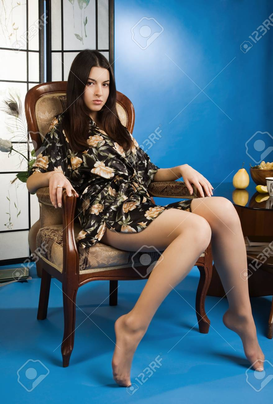Attractive lady in a blue colors boudoir Stock Photo - 9125086
