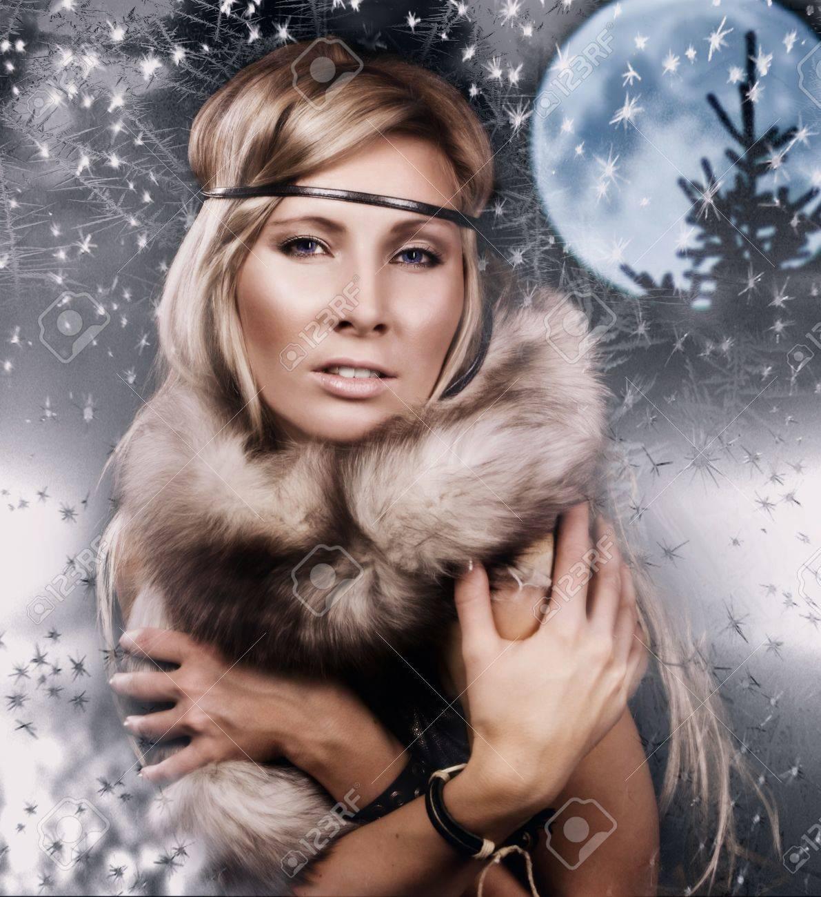 Snow Queen. Attractive girl in a fur cape on a snow winter landscape Stock Photo - 9125071