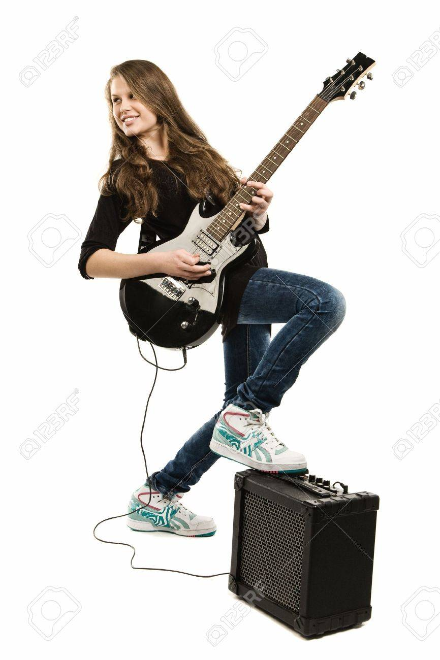 Teenager girl playing guitar against white background Stock Photo - 9126202
