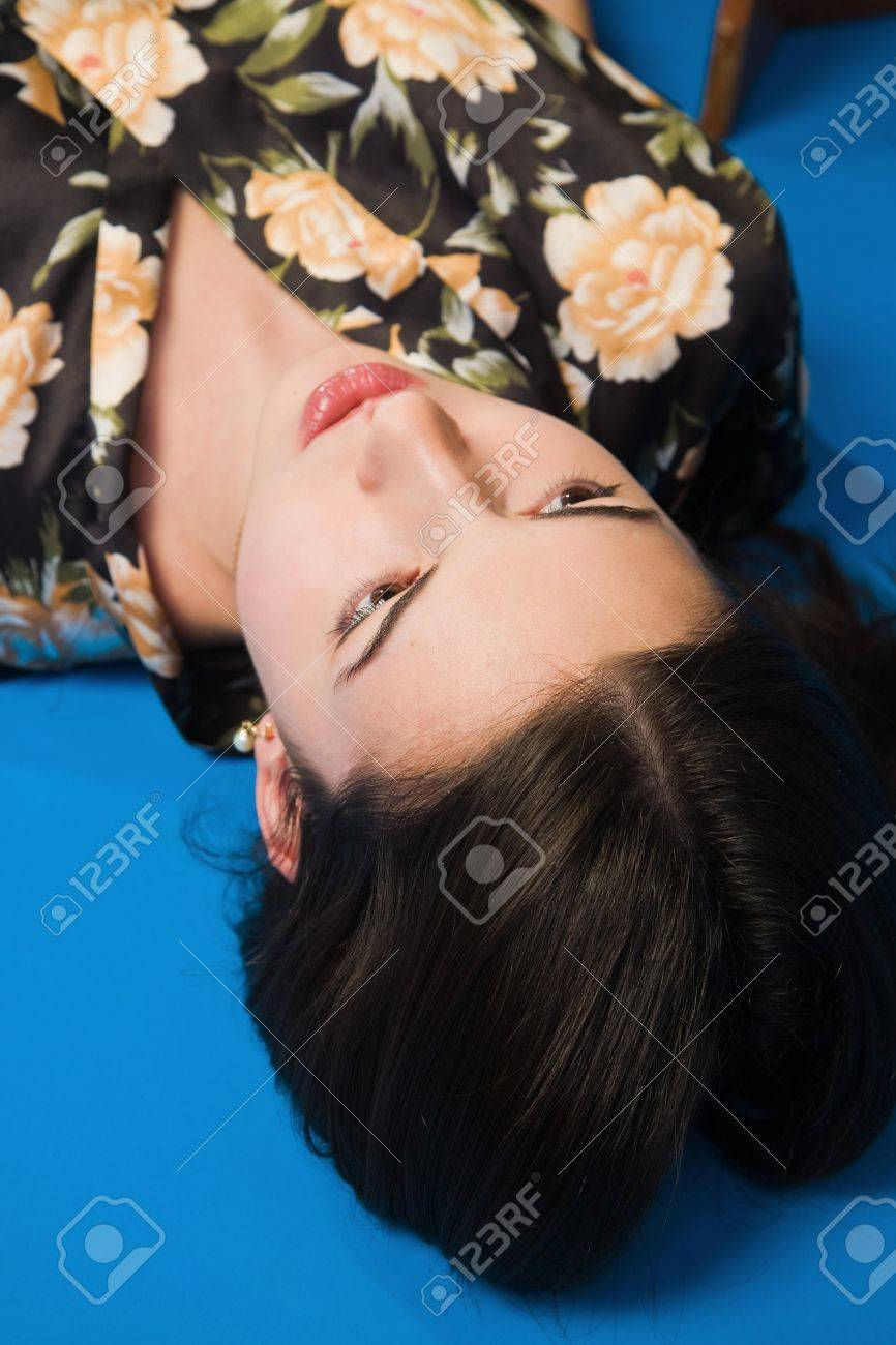 Lifeless brunette in a dressing gown lying on the floor Stock Photo - 9201872