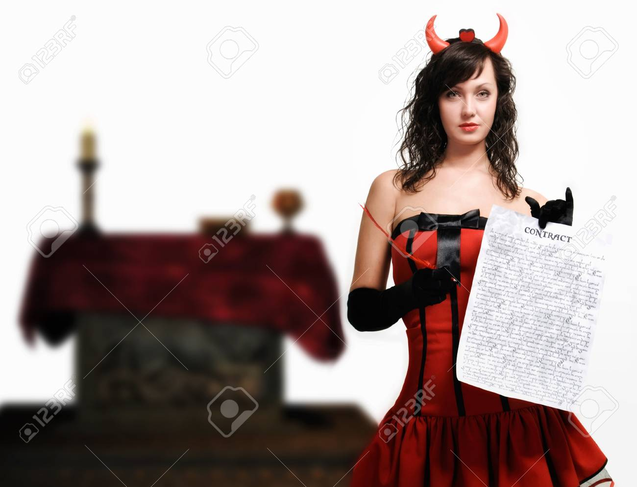 Beauty red devil girl with a contract over white Stock Photo - 9780527