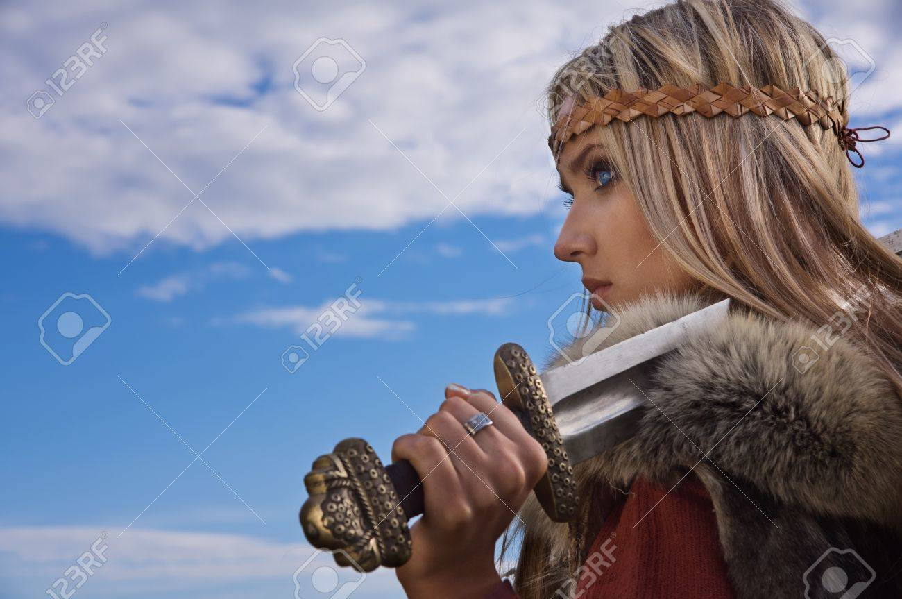 Blonde girl in the Scandinavian suit on a blue sky background Stock Photo - 9780824