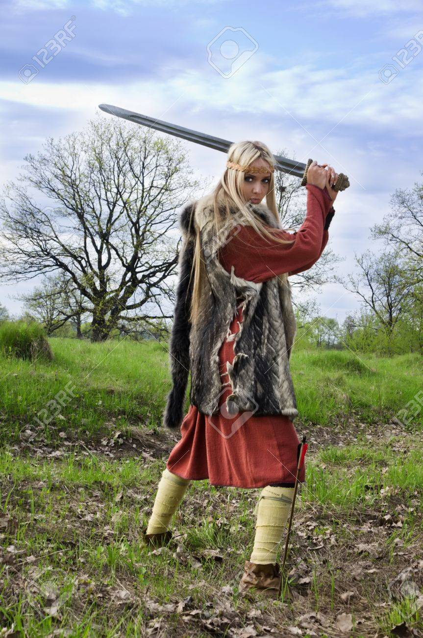 Viking girl warrior with sword in a fight Stock Photo - 9780822