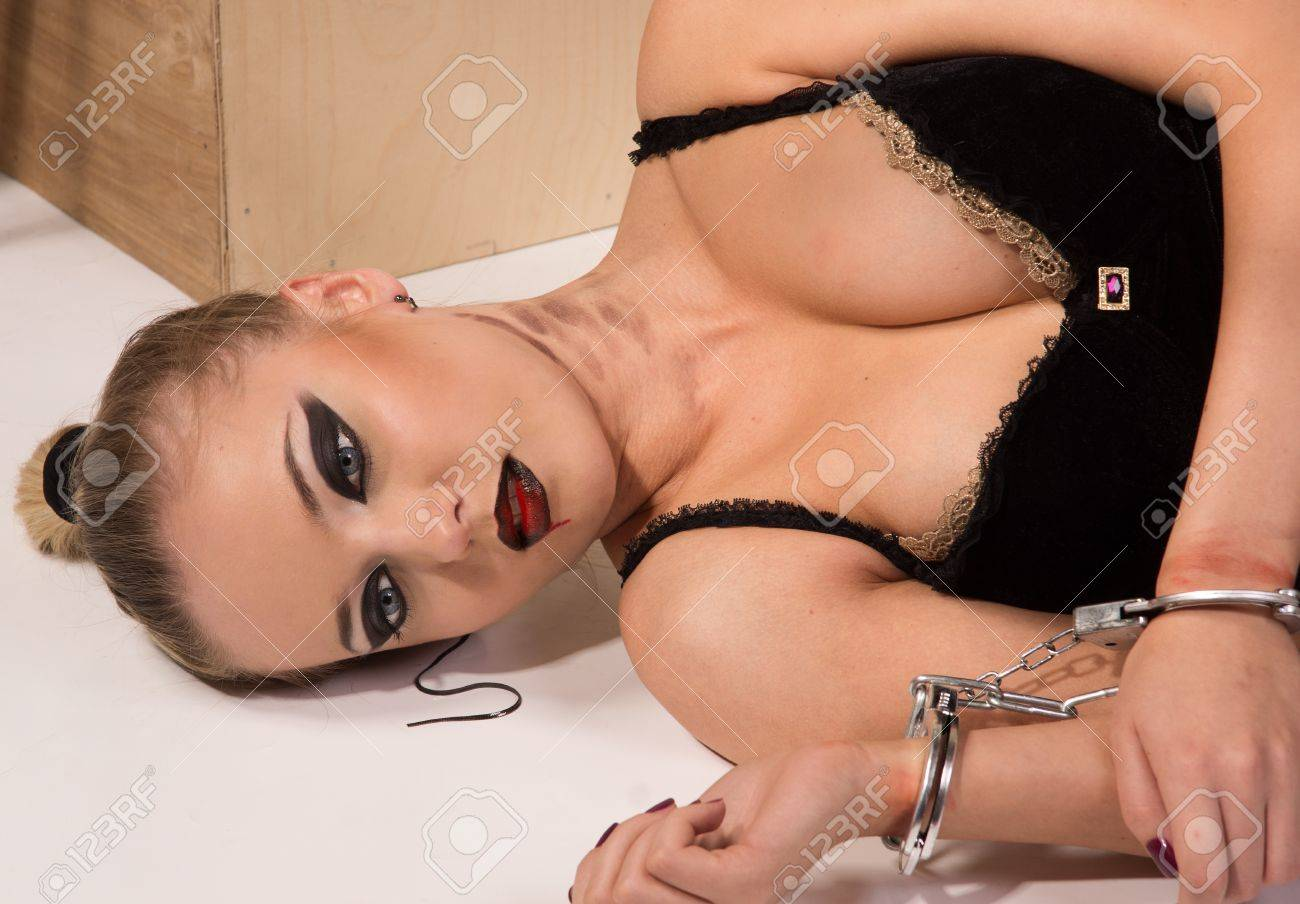 Crime scene simulation: dead blonde in the handcuffs lying on the floor Stock Photo - 10632024