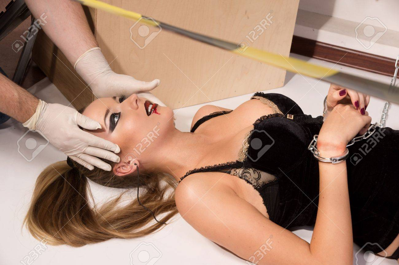 Forensic expert collecting evidence in a crime scene (imitation) Stock Photo - 10632032