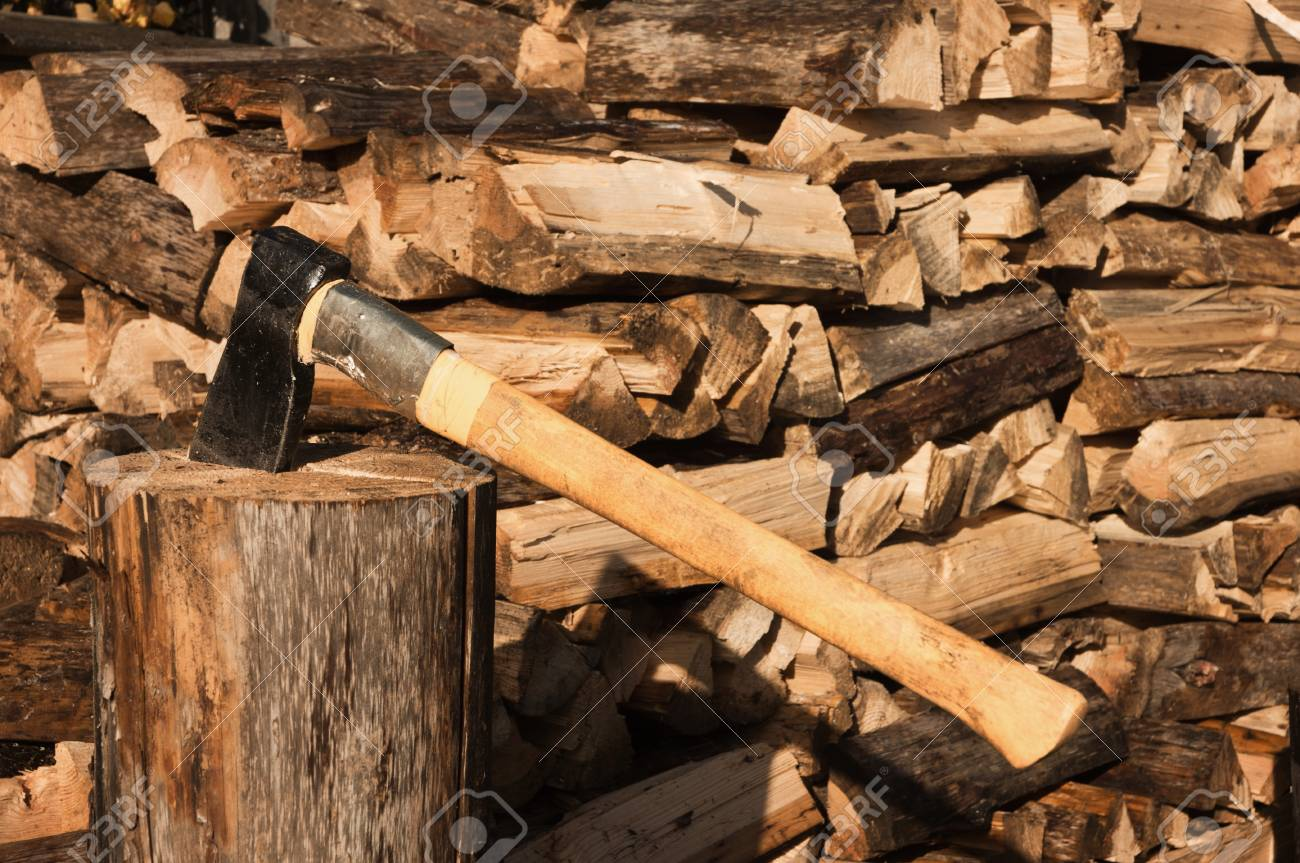 Axe in log on a firewoods background Stock Photo - 10632055