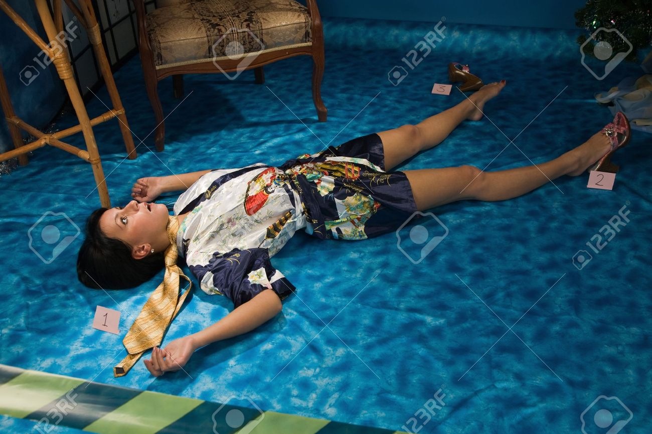 Crime scene simulation: strangled  brunette lying on the floor Stock Photo - 11010205