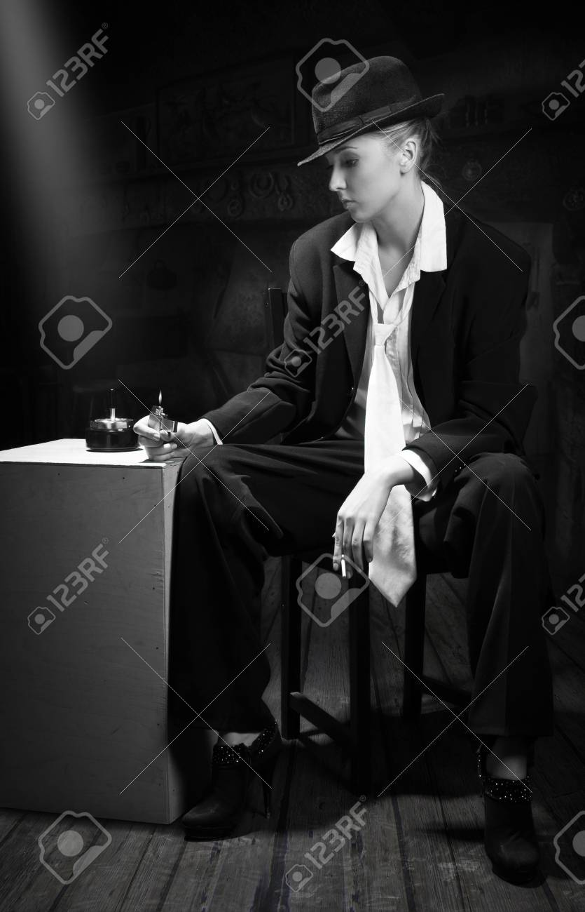 Vintage adult woman holding cigarette in bar Stock Photo - 11010150