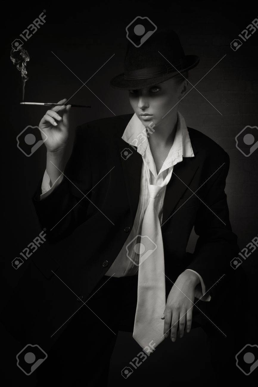 Vintage Woman Holding Cigarette In Mouthpiece Bar Stock Photo