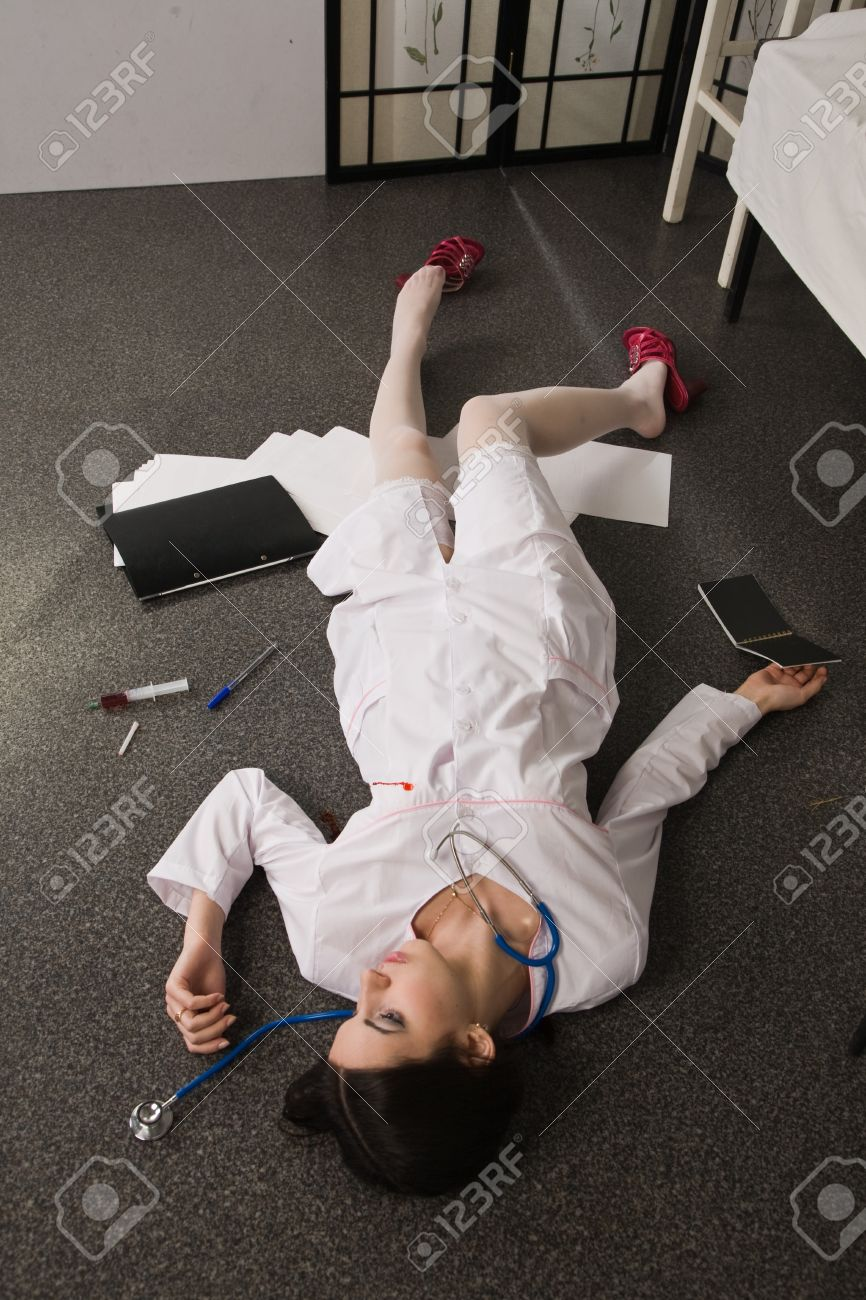 Crime scene imitation. Nurse lying on the floor Stock Photo - 11432930
