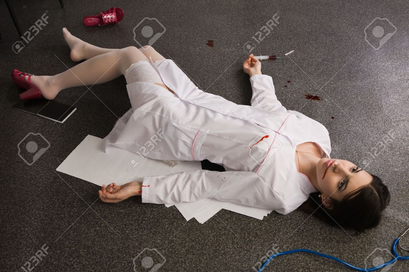 Crime scene imitation. Nurse lying on the floor Stock Photo - 11432935