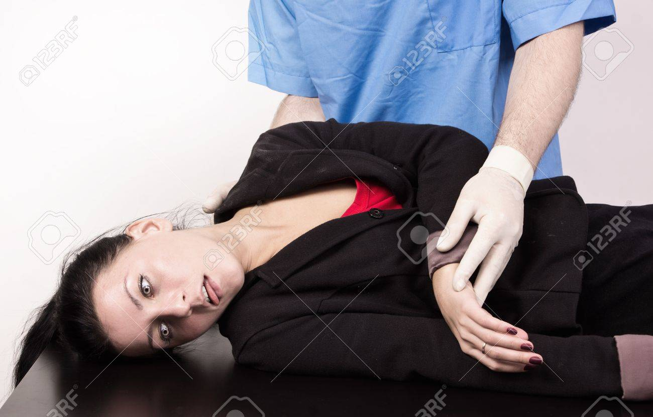 Coroner inspects the body of the crime victim  imitation Stock Photo - 12542446