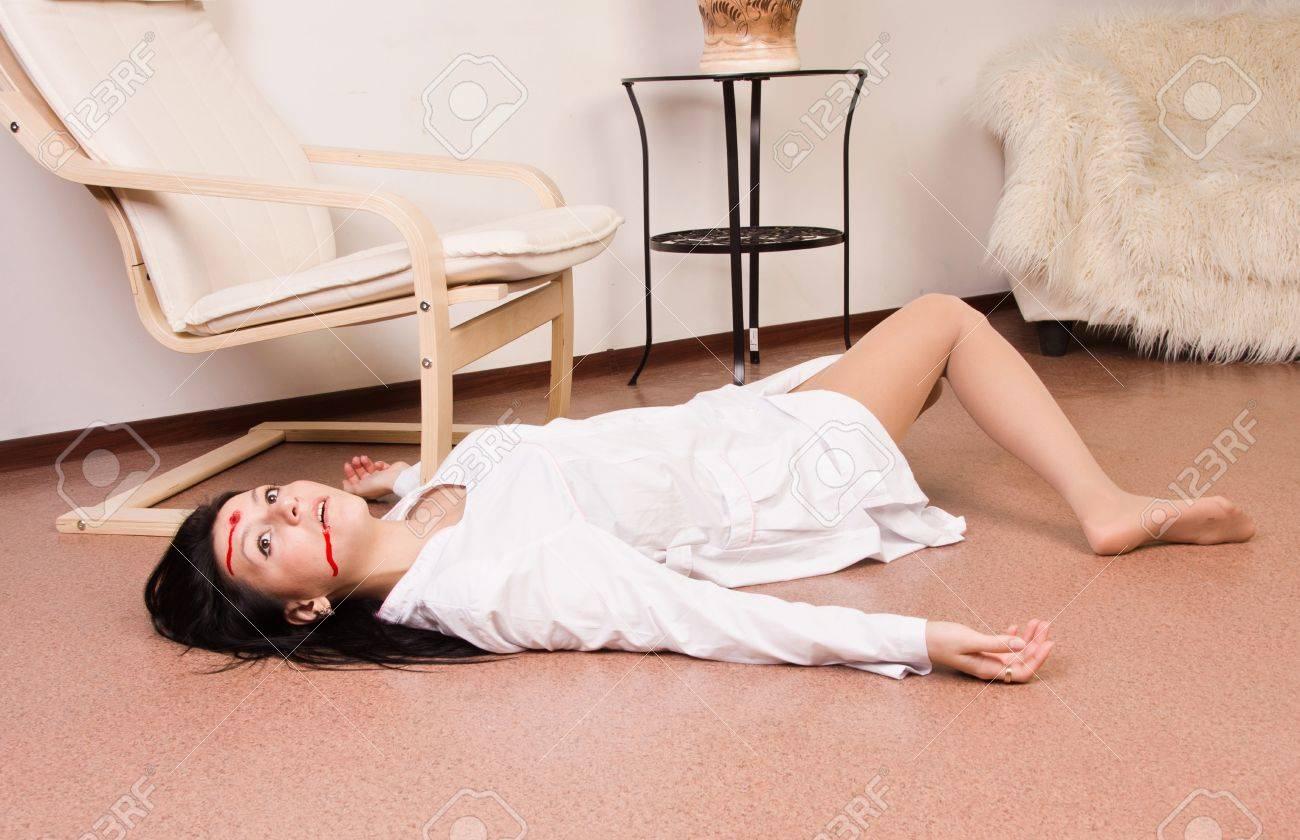 Crime scene imitation. Lifeless nurse lying on the floor Stock Photo - 13761650