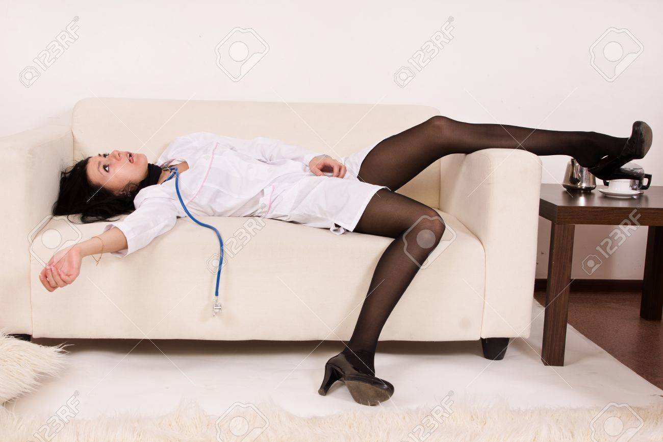 Crime scene imitation. Nurse lying on the sofa Stock Photo - 13761584