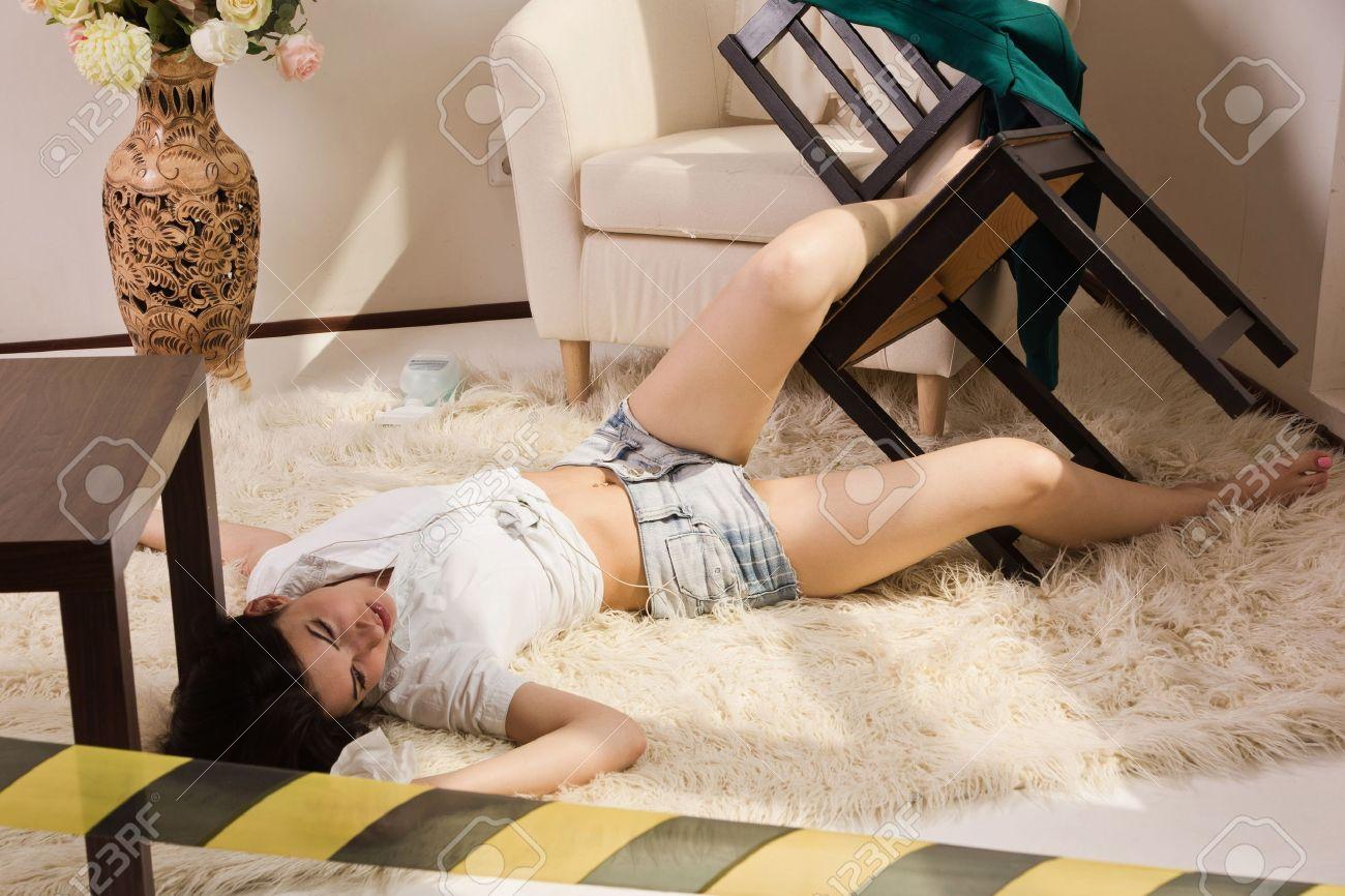 Crime scene imitation. Lifeless woman lying on the floor Stock Photo - 15134756
