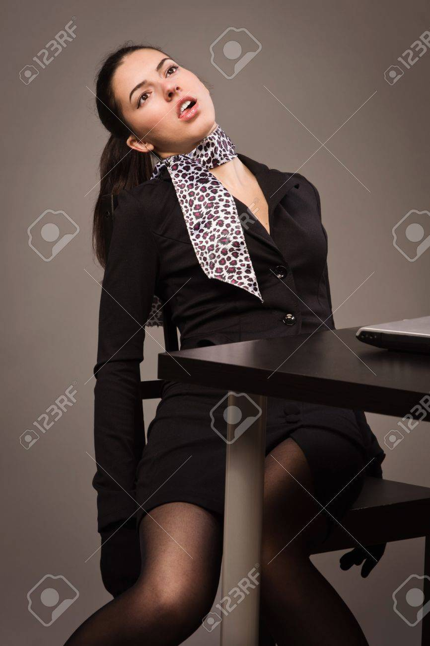 Detective scene imitation. Lifeless woman in a black suit sitting on a office table Stock Photo - 16383135