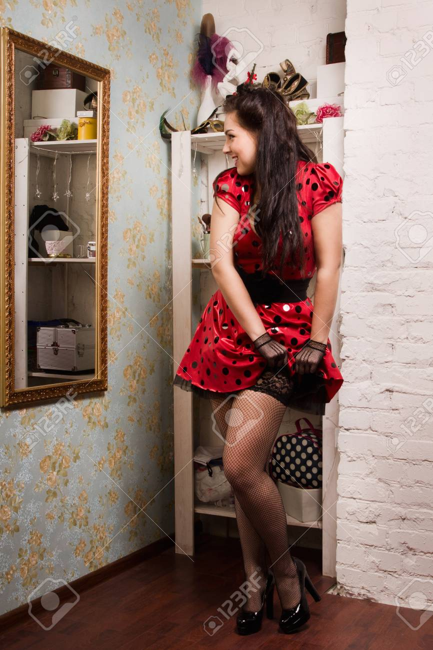 Attractive pin-up girl in the interior of the boudoir Stock Photo - 17449924