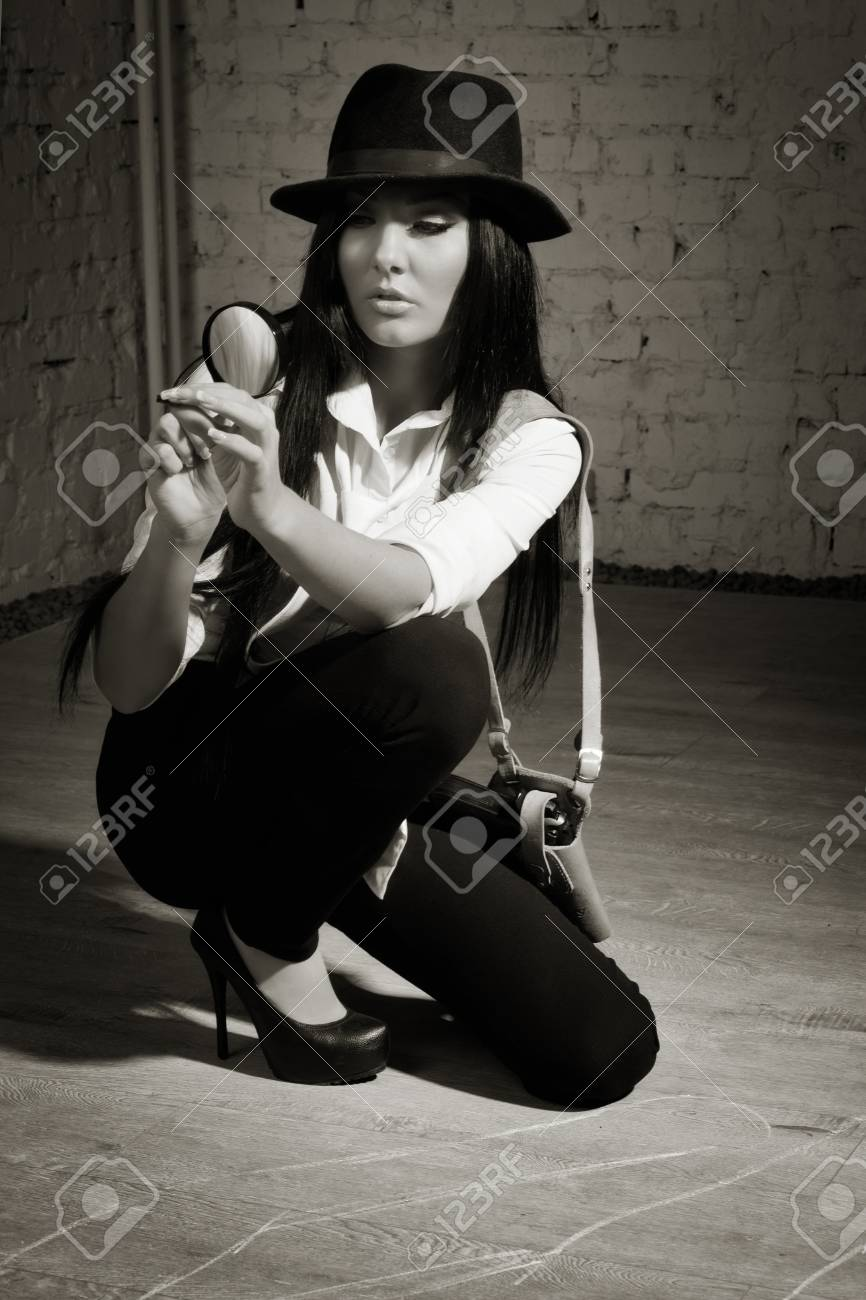 Retro detective sees the evidence in the magnifier Stock Photo - 17449934