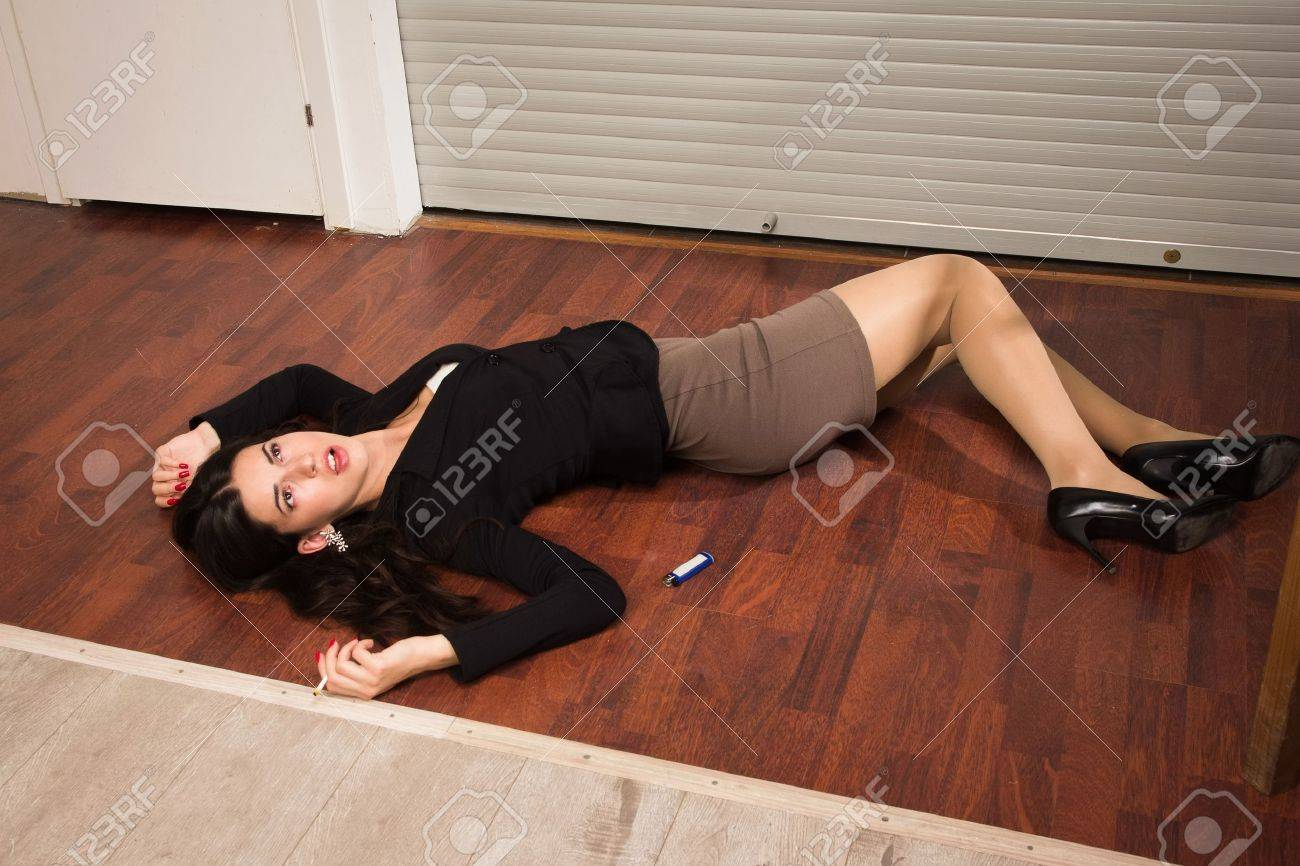 Crime scene in a office with lifeless businesswoman lying on the floor Stock Photo - 21704468