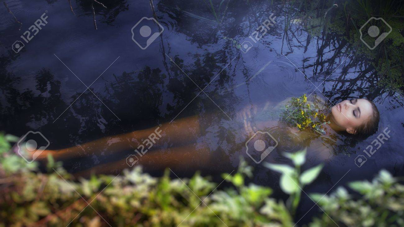 Young drown woman in a poetic representation. Stock Photo - 21848388