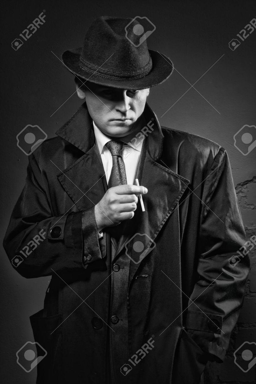 film noir retro styled fashion portrait of a detective stock photo