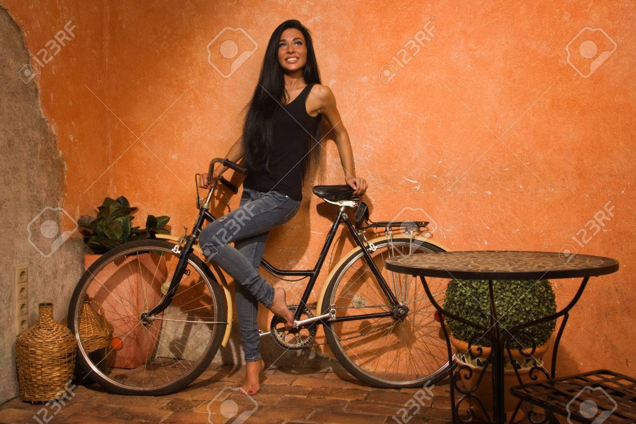 https://previews.123rf.com/images/demian1975/demian19751410/demian1975141000629/32429470-beautiful-girl-with-a-bicycle-on-the-street-of-the-old-town.jpg