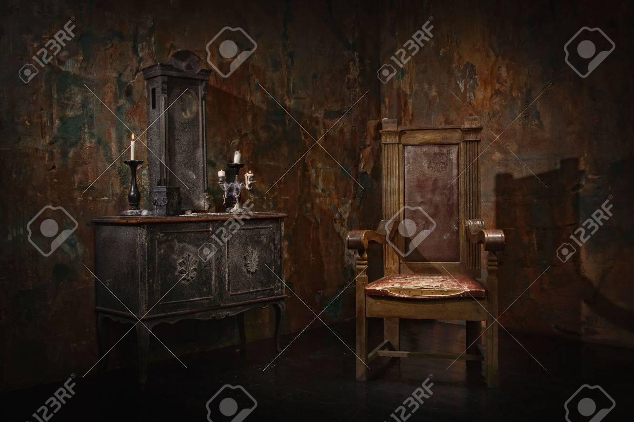 Mystical dark interior against a grungy brick wall - 57244906