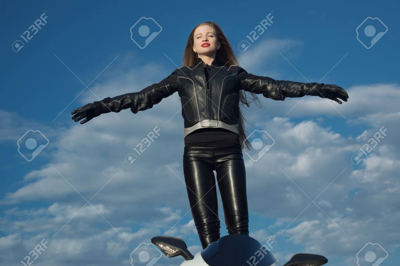 427beedce Sexy Biker Girl In A Leather Jacket On A Motorcycle Stock Photo ...