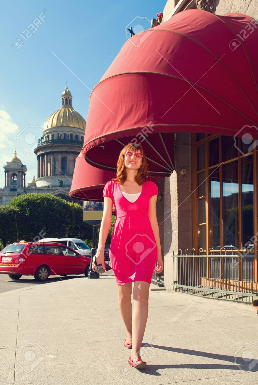 The young girl walks on a background of sights of city Stock Photo - 22007748