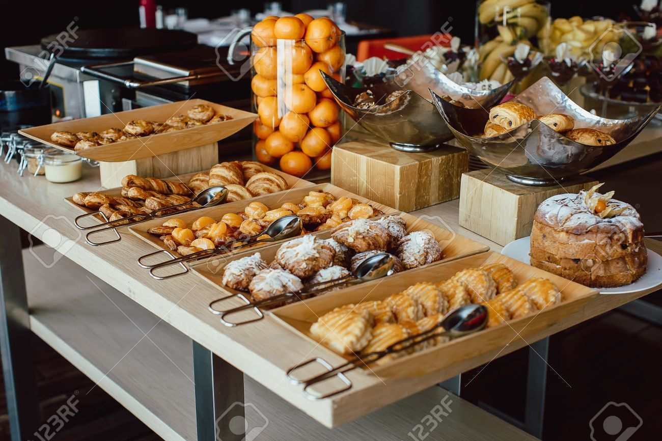 Assortment Of Fresh Pastry And Mandarin On Table In Buffet Stock Photo    59414603