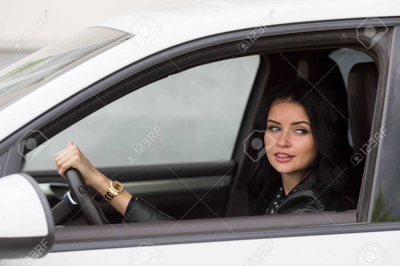 Pretty Young Woman Sitting Inside the Car, Smiling Look away