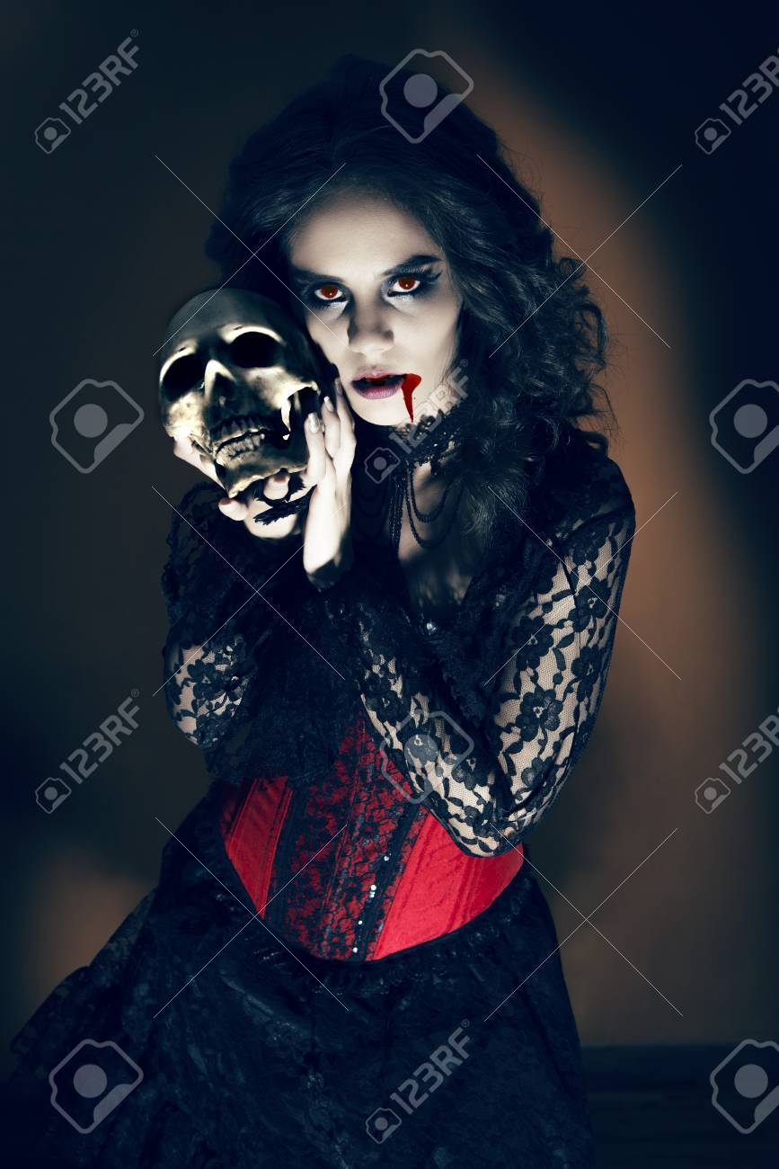 0f5845fe9 Devil Girl With Skull Stock Photo, Picture And Royalty Free Image ...
