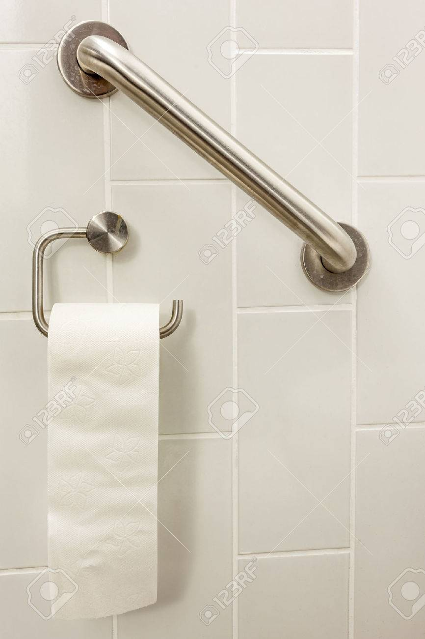 in an invalid toilet is there an bar and toilet paper - 31910464