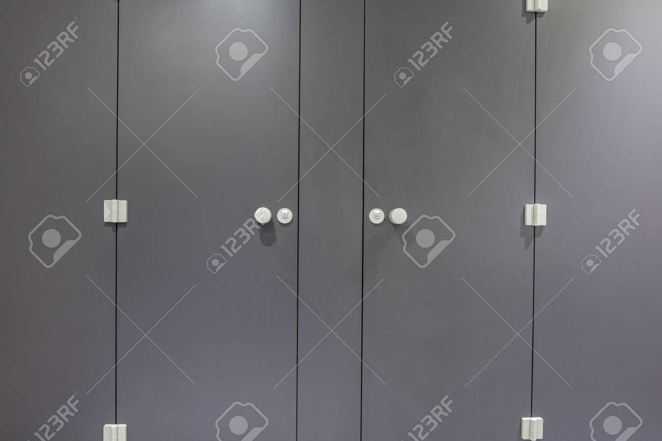 Mens restroom in an public building in gray doors - 33927891