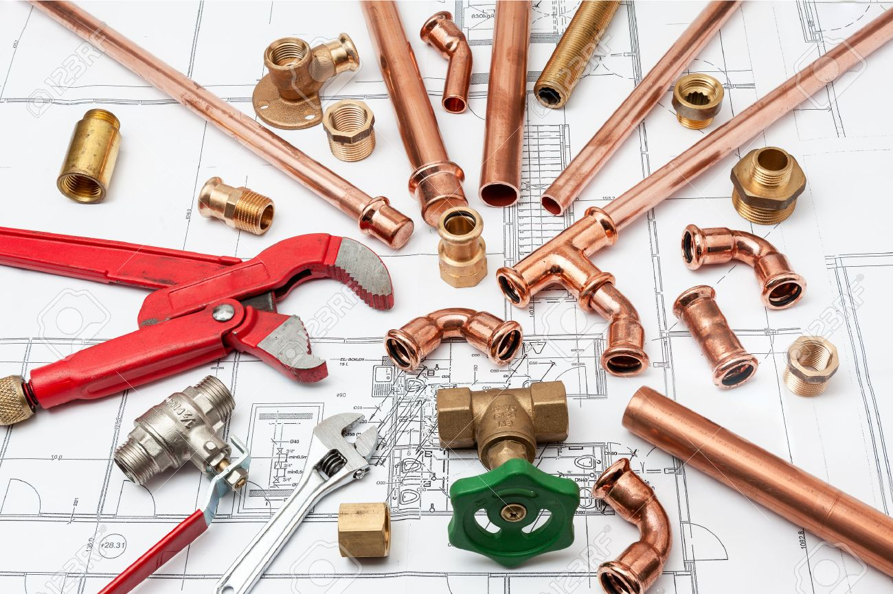 Plumbing Tools Arranged On House Plans whit wrench and pipe cutter - 34202244