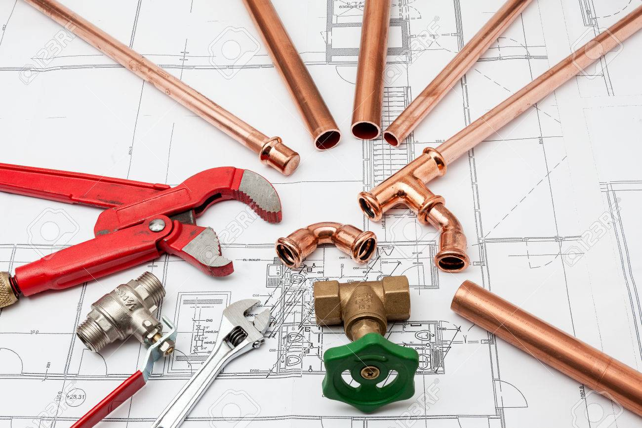 Plumbing Tools Arranged On House Plans whit wrench and pipe cutter - 34217539