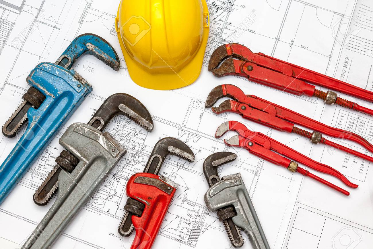 Plumbing Tools Arranged On House Plans whit wrench and water valves - 34610140
