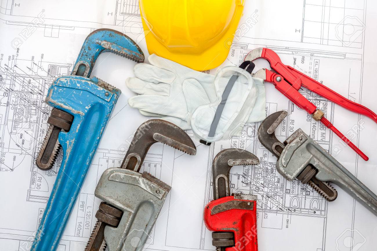 Plumbing Tools Arranged On House Plans whit wrench and water valves - 35154043
