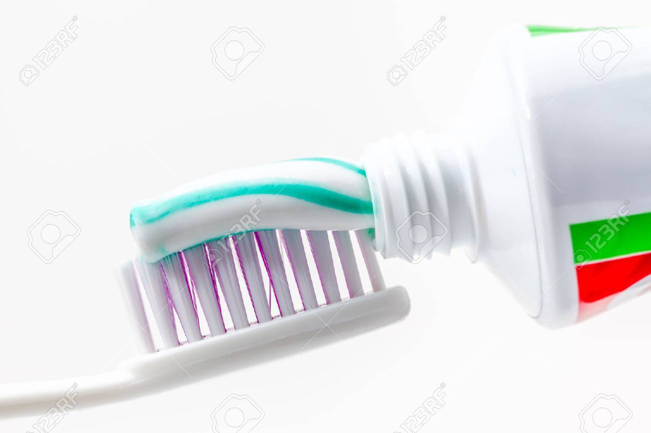 an toothbrush with toothpaste with green and white colors - 35762879