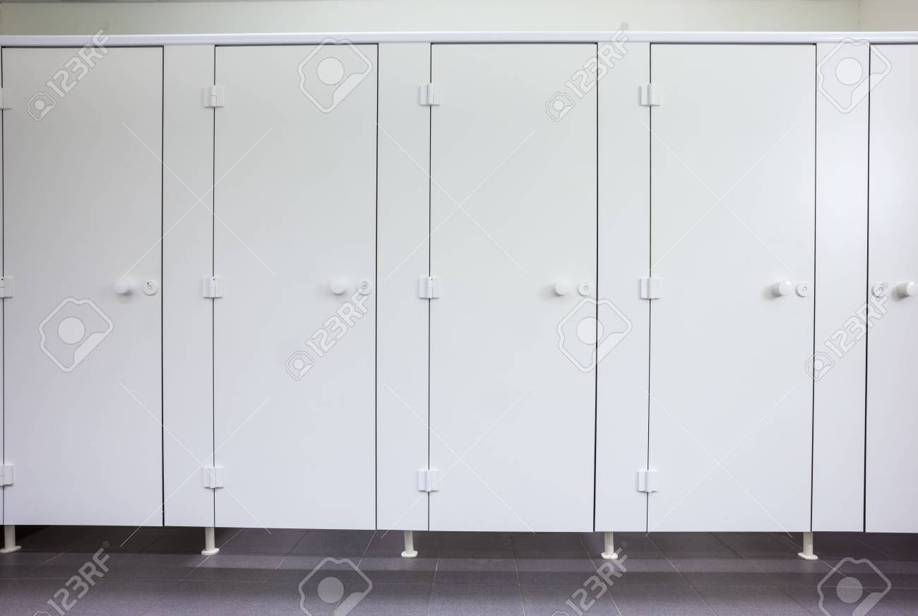 In an public building are womans toilets whit white doors - 51570272