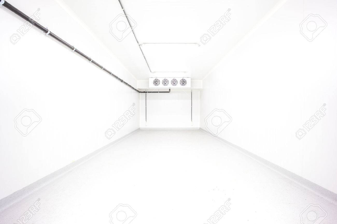 an empty industrial room refrigerator with four fans - 57426602