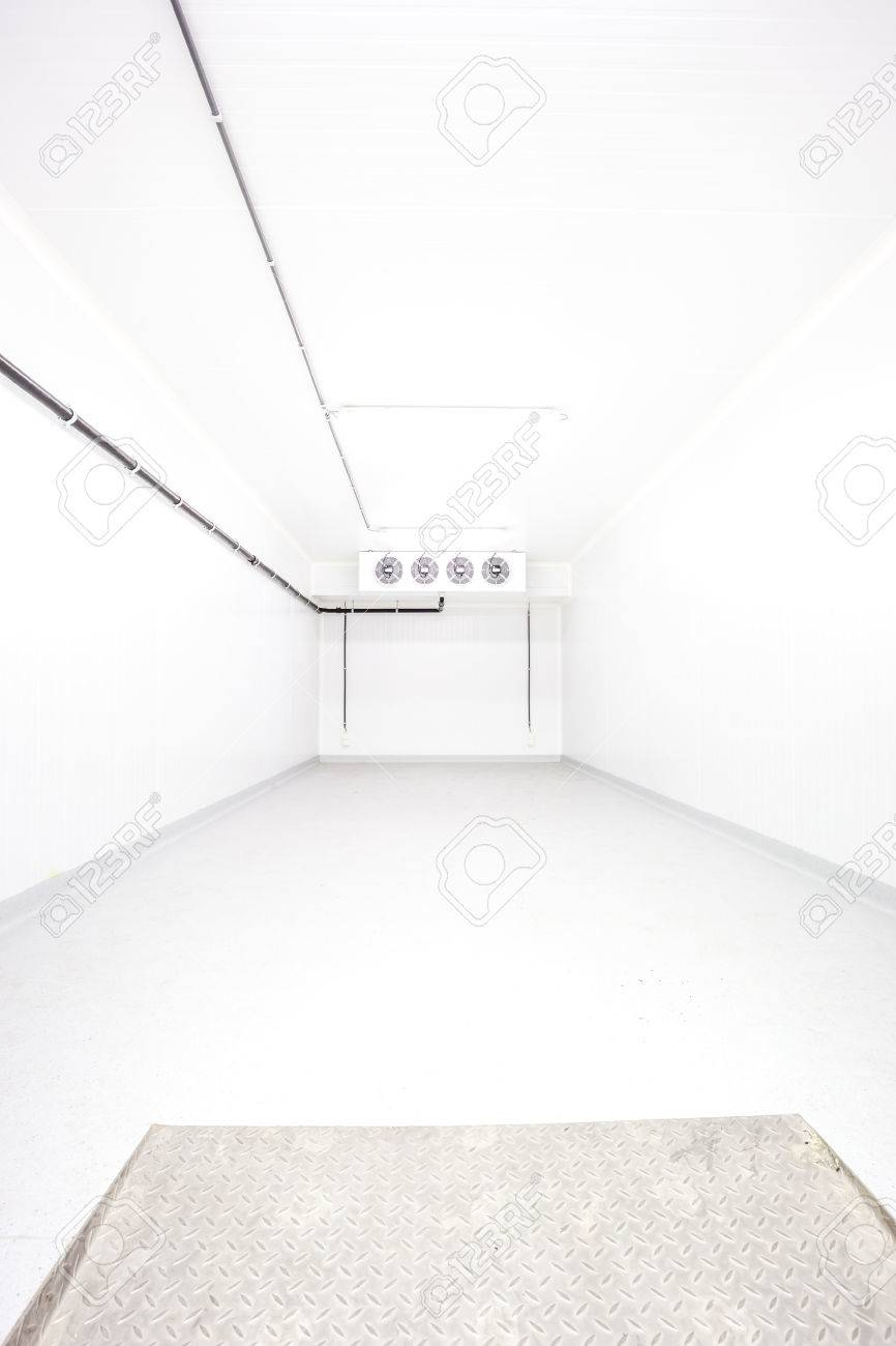 An Empty Industrial Room Refrigerator With Four Fans Stock Photo