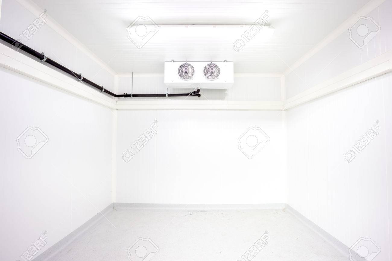 An Empty Industrial Room Refrigerator With Two Fans Stock Photo