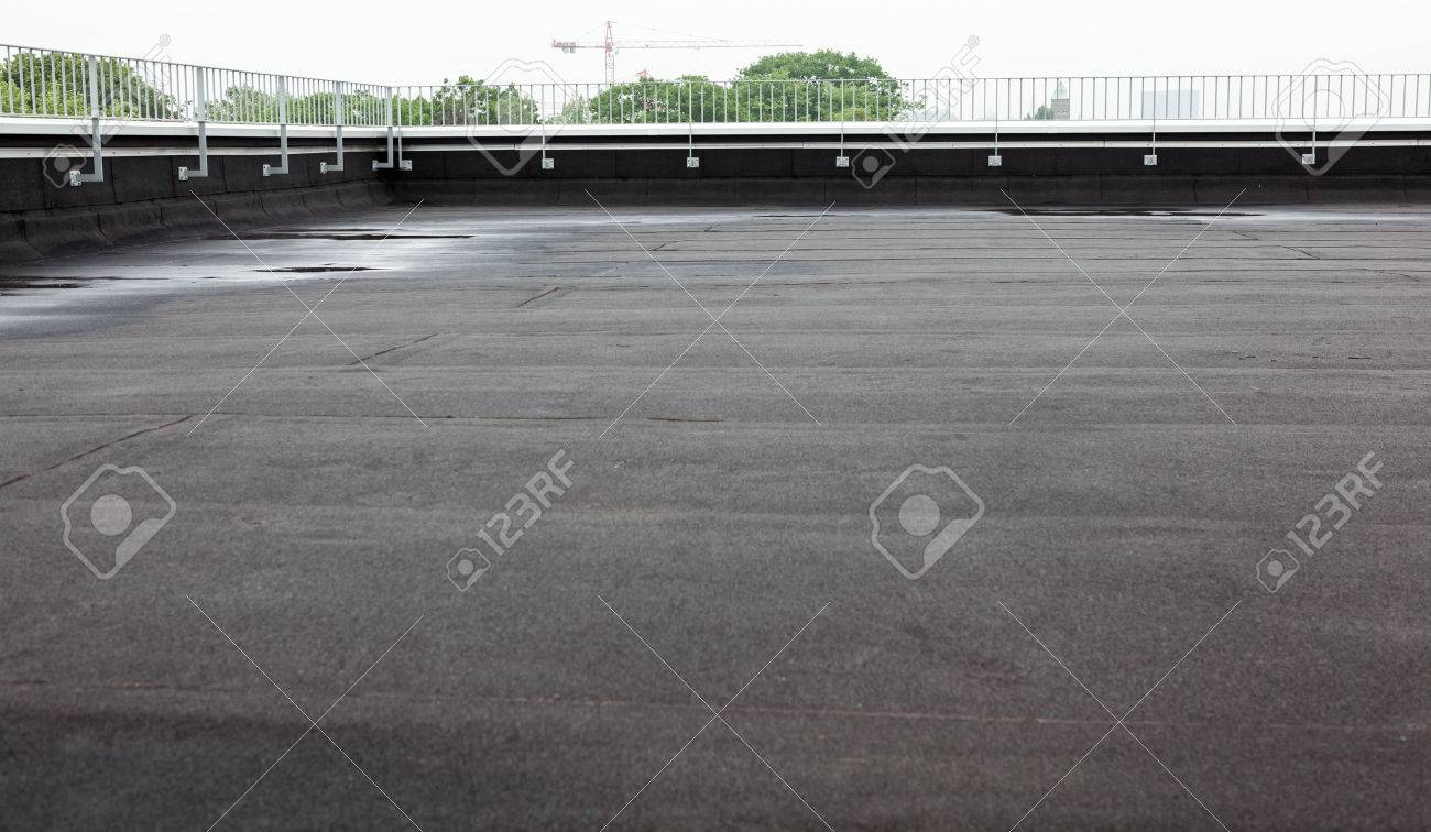 an flat roof with roofing and fencing - 60661794
