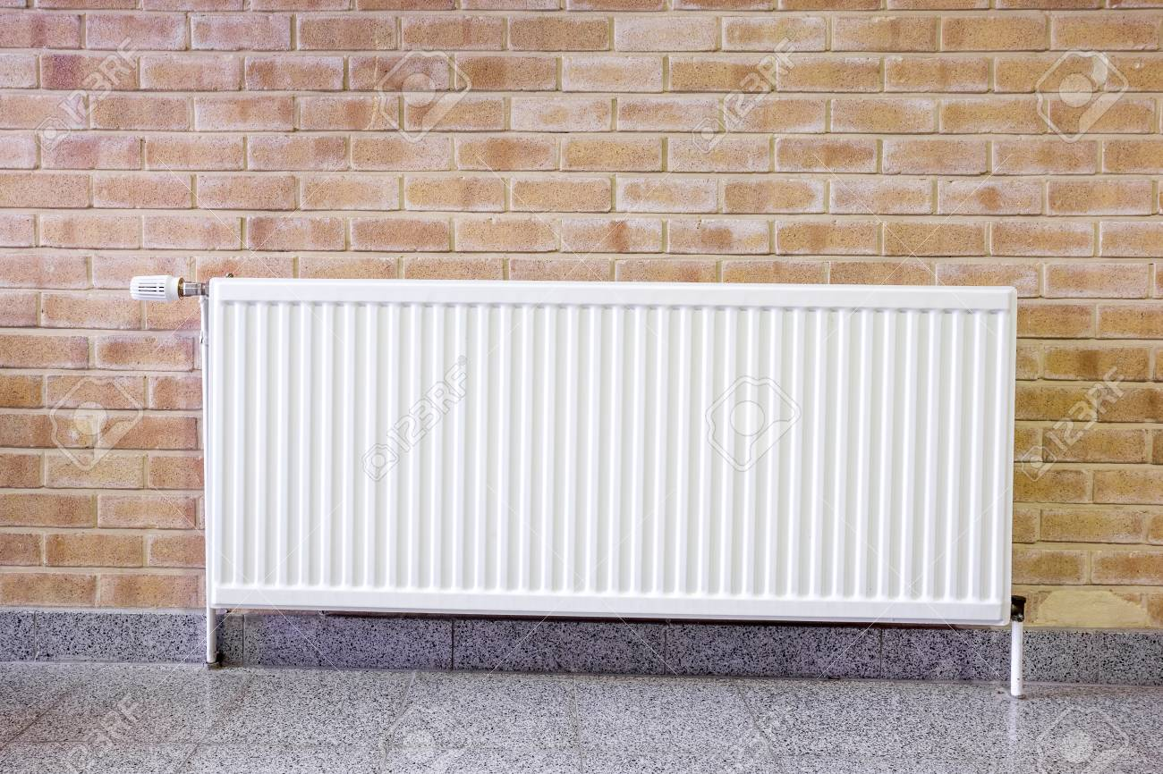 On Concrete Wall Hang An Radiator In Working In The Wall Stock Photo