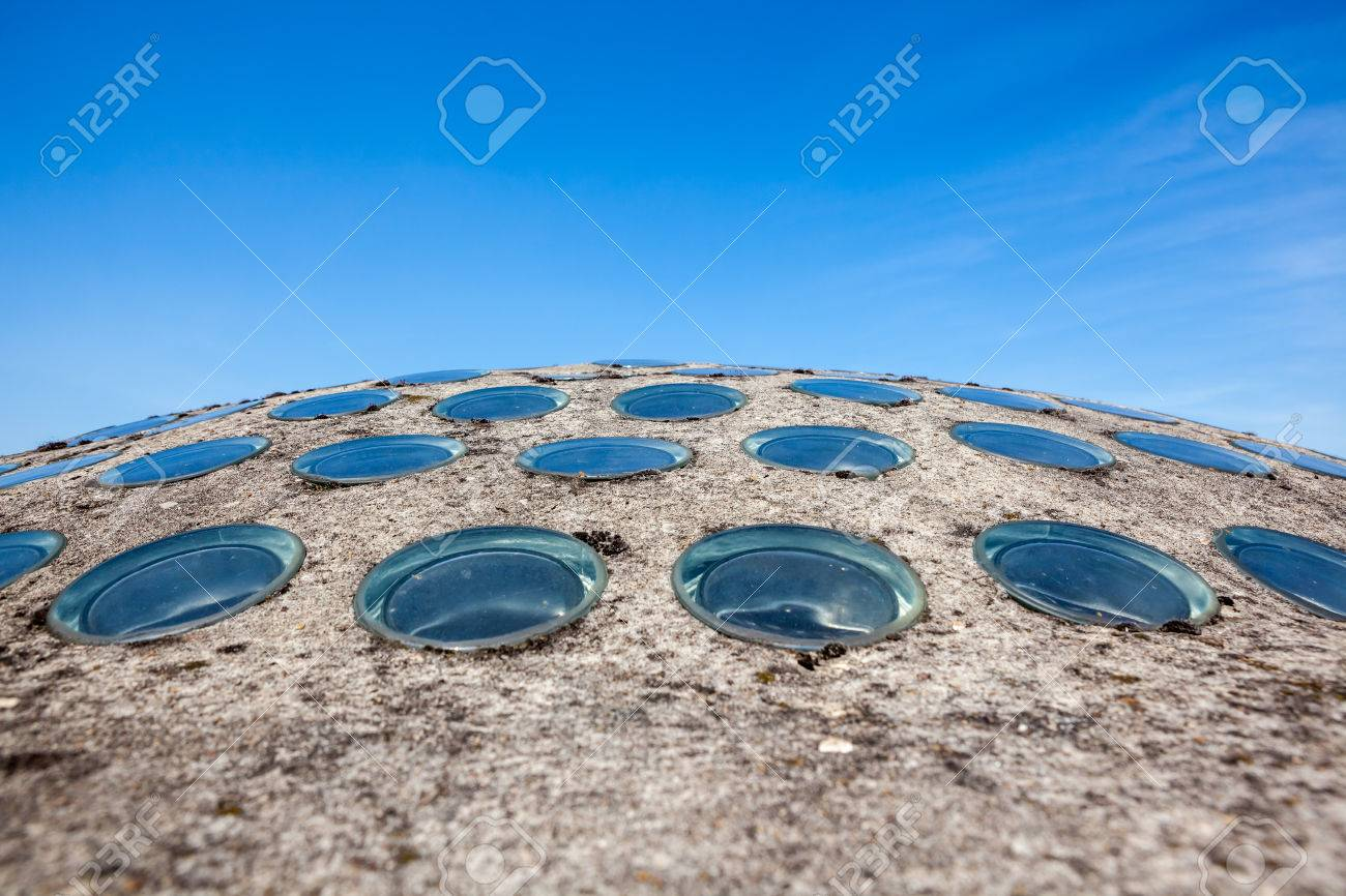 on the roof of a building there is a concrete dome with small