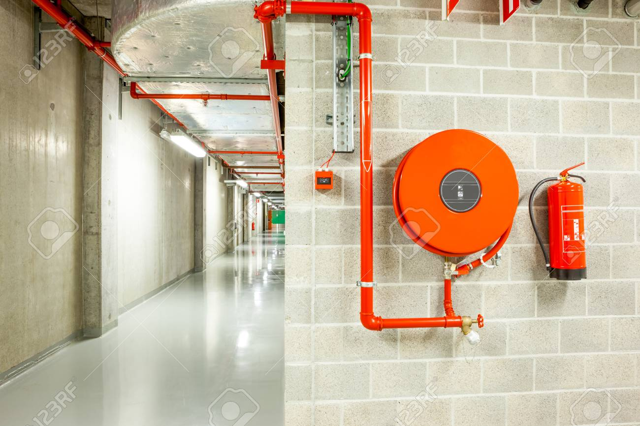an fire hose hanging on the wall in an staircase - 66567797